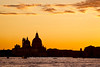 Basilica of Santa Maria della Salute silhouetted by the setting sun, Venice, Italy