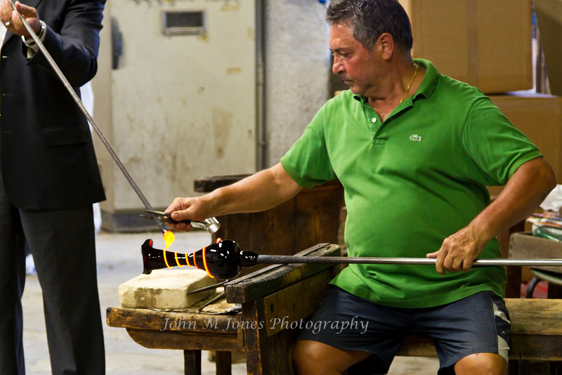 Craftsman at work in glass factory in Murano, Venetian Lagoon, Italy