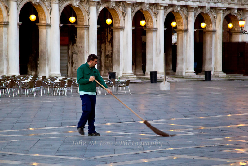 Street sweeper in St. Mark's Square, Venice, Italy