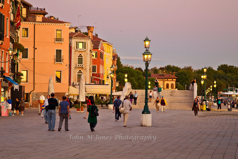 Street scene along the Riva degli Schiavoni walkway at sunset, Venice, Italy