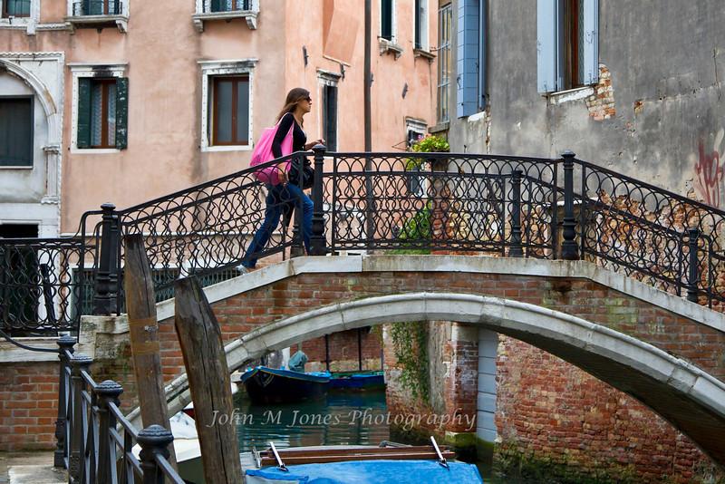 Woman on bridge, Venice, Italy