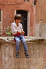 Young boy on well-head, Venice, Italy