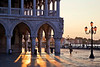 Sunrise through the colonnade of Palazzo Ducale or Doge's Palace, St. Mark's Square, Venice, Italy