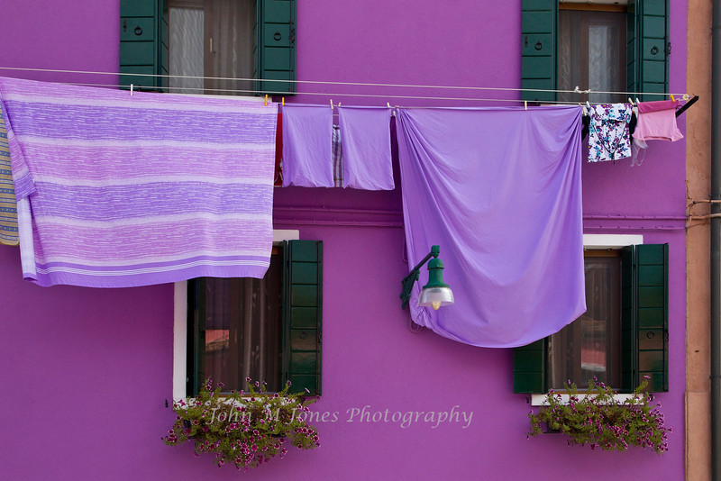 Colorful house with matching laundry in Burano, Venetian lagoon, Italy