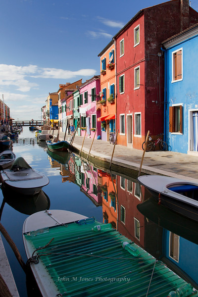 Colorful shops and houses in Burano, Venetian Lagoon, Italy