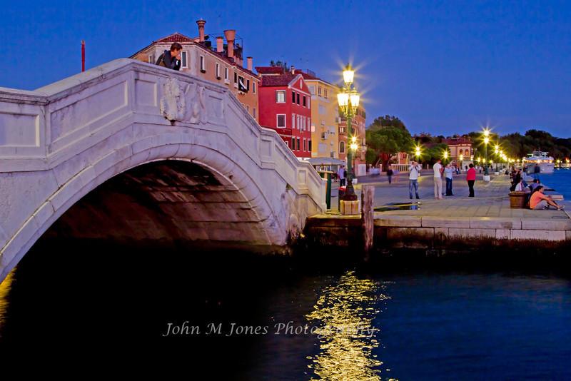 Evening street scene along the Riva degli Schiavoni walkway, Venice, Italy