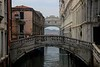 Rio de Palazzo-the canal under the ornate Bridge of sighs, which is a transfer bridge from the reddish prison at left to the Doges Palace court on the right.