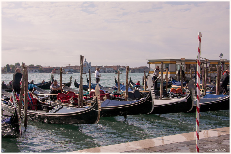 Gondoliers along the Riva d Schiavone waiting for customers.