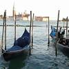 Gondolas docked along the canal in Venice, Italy.