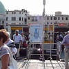 Water bus passengers get off at the dock in front of the Santa Lucia train station along the canal in Venice, Italy.