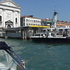 A view from the water taxi while cruising along the canal in Venice, Italy.