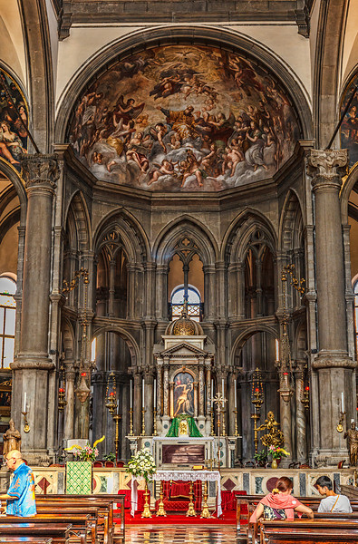 Exquisitely decorated church interior with frescas and gilded statues.