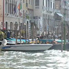 Gondolas and boats docked along the canal in Venice, Italy.