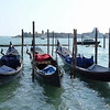 Gondolas docked along the canal in Venice, Italy.