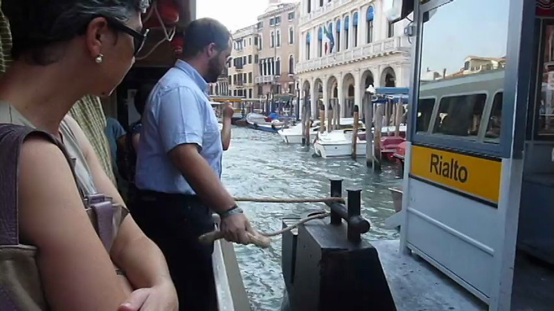 Water bus passengers get off at the dock station along the canal in Venice, Italy.