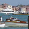 Boats and water taxi cruising along in Venice, Italy.