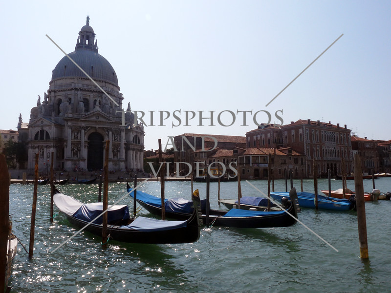 Gondolas parked along the Grand Canal in Venice, Italy.