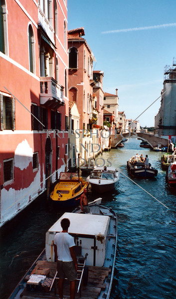 Water taxies and boats cruising the canal in Venice, Italy.