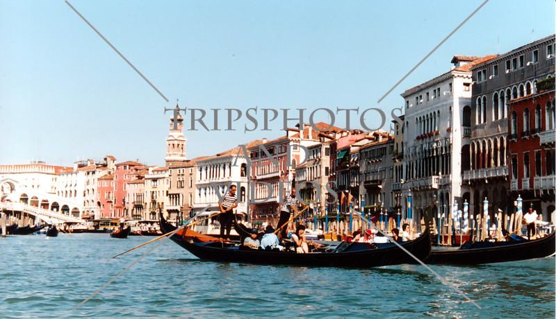 Gondola boats cruising the grand canal in Venice, Italy.