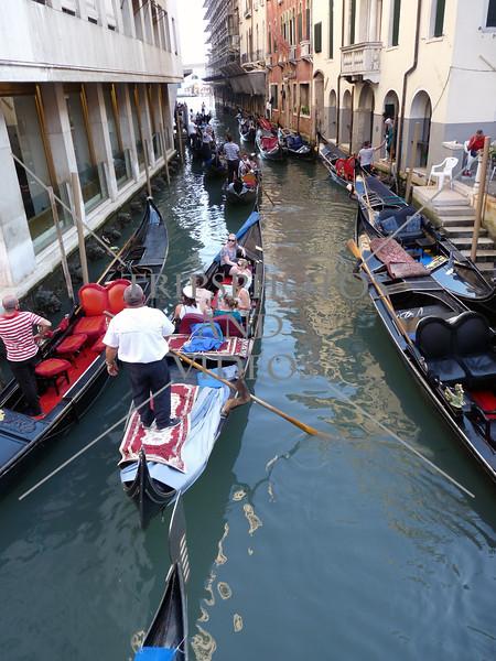 Gondolas cruising the canal in Venice, Italy.