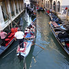Gondolas cruising the canal in Venice, Italy.