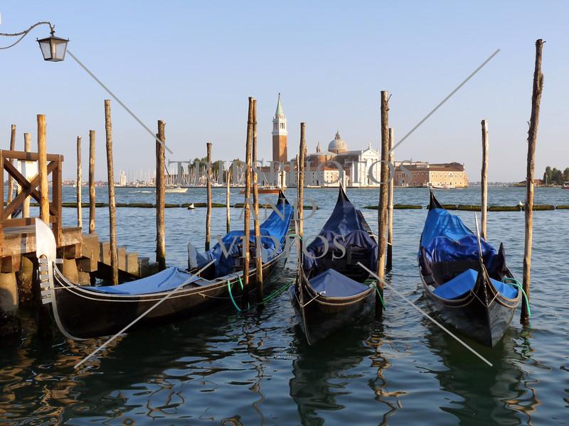 Gondolas at the dock in Venice, Italy.