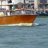 A water taxi boat cruising the water of Venice, Italy.