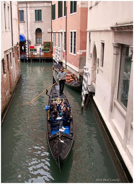 Gondolas plying their way under the Calle Dei Fabbri.