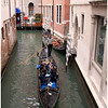 Gondolas plying their way under the Calle Dei Fabbri.