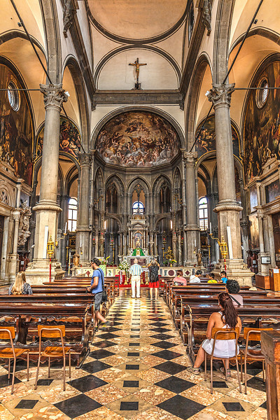 Beautiful frescas and gilded statues adorn the interior of this small church in Venice, Italy.