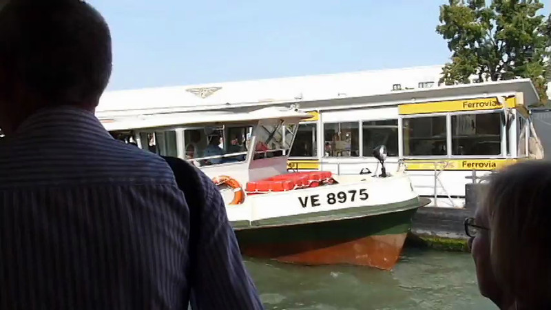 A view of the front of Santa Lucia train station while cruising along the canal in Venice, Italy.