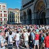 Wall to wall people in the Piazza San Marco in Venice.  St. Mark's Basilica is in the background on the right.