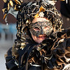 VENICE, ITALY - FEBRUARY 12: Unidentified persons in Venice mask at St. Mark's Square, Carnival of Venice on February 12, 2012. Annual carnival was held in 2012 from February 11 to February 21, 2012.