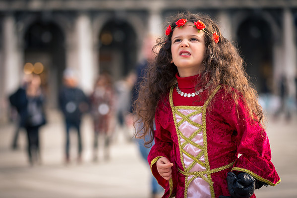 Costumes of vibrant colors on venetian carnival 2014, Venice, Italy