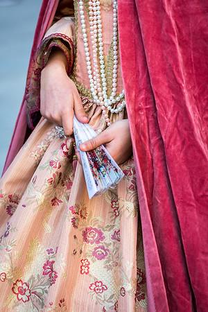 Beautiful woman´s costume of vibrant colors on venetian carnival 2014, Venice, Italy