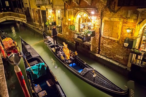 Nocturnal idyllic cruise on gondola, Venice, Italy