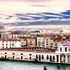 """Venice, Italy - The Giudecca Canal looking into the Grand Canal.  This point of land marks the divide between the Grand Canal and the Giudecca Canal.  To the right is the bell tower of the Church of San Stefano.  The low building in the center is the historical Library of European Linguistics.  To the far right is the Church of the Virgin Mary of Good Health, from the mid-17th century.  The church is one of the most well-known in Venice and is simply called """"Salute."""""""
