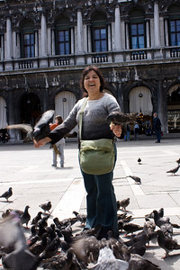 Deepu with pigeons at St Marks Square