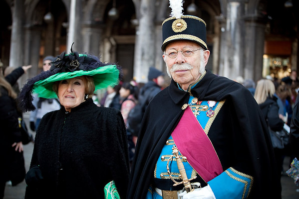 Man and woman in mask on carnival, Piazza San Marco, Venice, Italy