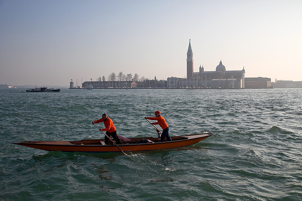 Two people in boat, Venice, Italy