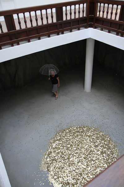 It's raining coins, but only on women. Russian exhibit. We're peering over the alter to money.