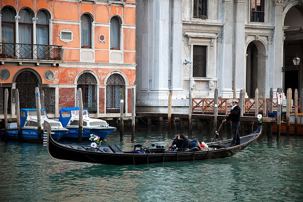 Gondola with tourists in Canal Grande, Venice, Italy