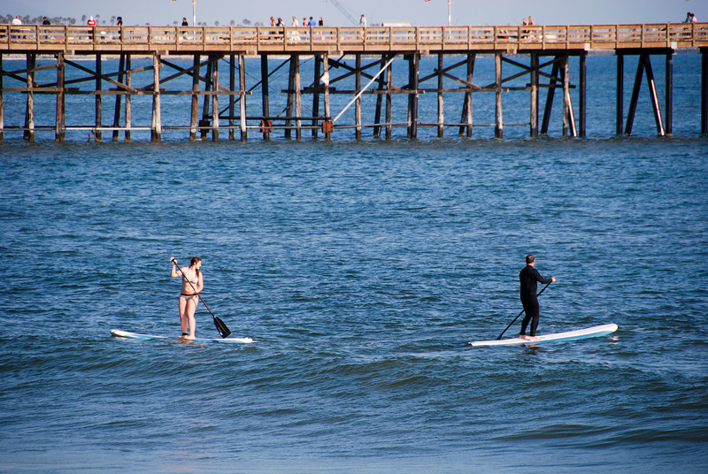 """<span id=""""title"""">Paddleboarders Proximal to Pier</span> Say that five time fast, too."""