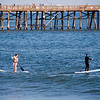 "<span id=""title"">Paddleboarders Proximal to Pier</span> Say that five time fast, too."