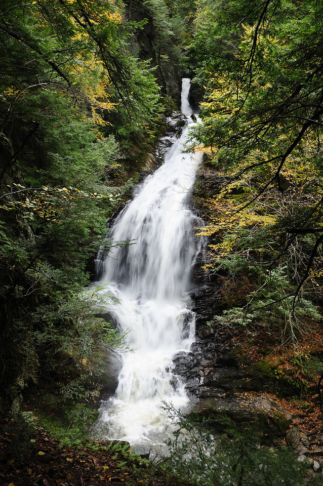 Moss Glen Falls in Stowe, Vermont, during early Autumn