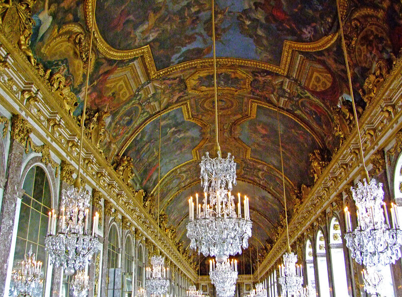 Hall of Mirrors.  The Treaty of Versailles was signed in this room ending World War I but the treaty terms were factors that led to World War II.