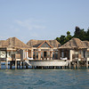 Song Saa Private Island, Koh Ouen and Koh Bong, Cambodia<br /> <br /> Number of Bungalows: 9<br /> <br /> What's Unique: This new resort is the first to be built on Cambodia's mostly untouched islands in the Koh Rong archipelago. Song Saa spreads across two islands which are connected by a footbridge over a marine reserve, and with any luck you'll spot one of the protected sea turtles or seahorses during your stay. The resort's ultramodern overwater villas have an air of always-been-here authenticity thanks to the reclaimed wood from retired fishing boats and local driftwood incorporated into the architecture and furnishings. The organic design manages to effortlessly blend luxuries like private infinity-edge pools, outdoor showers, and twin bathtubs into the surrounding rainforest.<br /> <br /> Over-the-Top Services: Indulge in a Buddhist-inspired treatment at the resort's rainforest wellness center or have local monks perform a traditional blessings ceremony for you. Staff can also turn your villa into a private cinema with a screen and projector for movie night.<br /> <br /> Rates: From $1,415 per night.