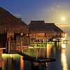 Hilton Moorea Lagoon Resort & Spa, Moorea Island, French Polynesia<br /> <br /> Number of Bungalows: 54<br /> <br /> What's Unique: These bungalows perch above the wide, shallow lagoon that surrounds the island of Moorea, a seven-minute flight from Tahiti. Located on Moorea's north side, Hilton Moorea Lagoon's bungalows are perfectly positioned for taking in views of sunrises, sunsets, and the island's mountain ridges. Bedrooms feature a glass floor panel, and large Italian bathrooms include marble flooring, rain showers, golden claw-foot tubs, and dual vessel sinks made of stone. You can snorkel right off your deck. At night, sharks are occasionally sighted beneath the boardwalk at the resort's Toatea Bar.<br /> <br /> Over-the-Top Services: There's private butler service to cater to your every whim. You can have breakfast delivered by canoe or a romantic dinner on your deck. When you order turndown service you're greeted with lit candles, essential-oil aromas, soft music, and flowers on the bed and floor.<br /> <br /> Rates: From 73,000 XPF (about $790) per night.