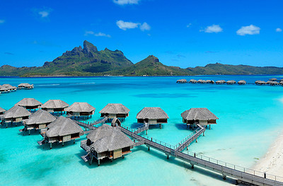Four Seasons Resort Bora Bora, Motu Tehotu, French Polynesia  Number of Bungalows: 100  What's Unique: The classic magazine cover shot, Four Seasons Resort Bora Bora's picturesque string of bungalows arcs over turquoise South Pacific waters at the foot of Mt. Otemanu. The bungalows, fanning out from a lush private island, are some of the newest and most luxurious in French Polynesia. And, at the moment, they rank #1 on TripAdvisor for Bora Bora accommodations. Most thatched-roof bungalows have glass floor panels that look into the lagoon and some have private infinity-edge pools. The resort's own marine biologist grafts coral and offers tours of the lagoon sanctuary.  Over-the-Top Services: Breakfast is delivered to you in a ceremonial Polynesian canoe and served with fragrant bouquets of flowers. As your table is being set, you can take a short canoe ride with a rower and wake to the sounds of Tahitian song.  Rates: From 80,000 to 110,000 XPF (about $860 to $1,190) per night.