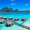 Four Seasons Resort Bora Bora, Motu Tehotu, French Polynesia<br /> <br /> Number of Bungalows: 100<br /> <br /> What's Unique: The classic magazine cover shot, Four Seasons Resort Bora Bora's picturesque string of bungalows arcs over turquoise South Pacific waters at the foot of Mt. Otemanu. The bungalows, fanning out from a lush private island, are some of the newest and most luxurious in French Polynesia. And, at the moment, they rank #1 on TripAdvisor for Bora Bora accommodations. Most thatched-roof bungalows have glass floor panels that look into the lagoon and some have private infinity-edge pools. The resort's own marine biologist grafts coral and offers tours of the lagoon sanctuary.<br /> <br /> Over-the-Top Services: Breakfast is delivered to you in a ceremonial Polynesian canoe and served with fragrant bouquets of flowers. As your table is being set, you can take a short canoe ride with a rower and wake to the sounds of Tahitian song.<br /> <br /> Rates: From 80,000 to 110,000 XPF (about $860 to $1,190) per night.